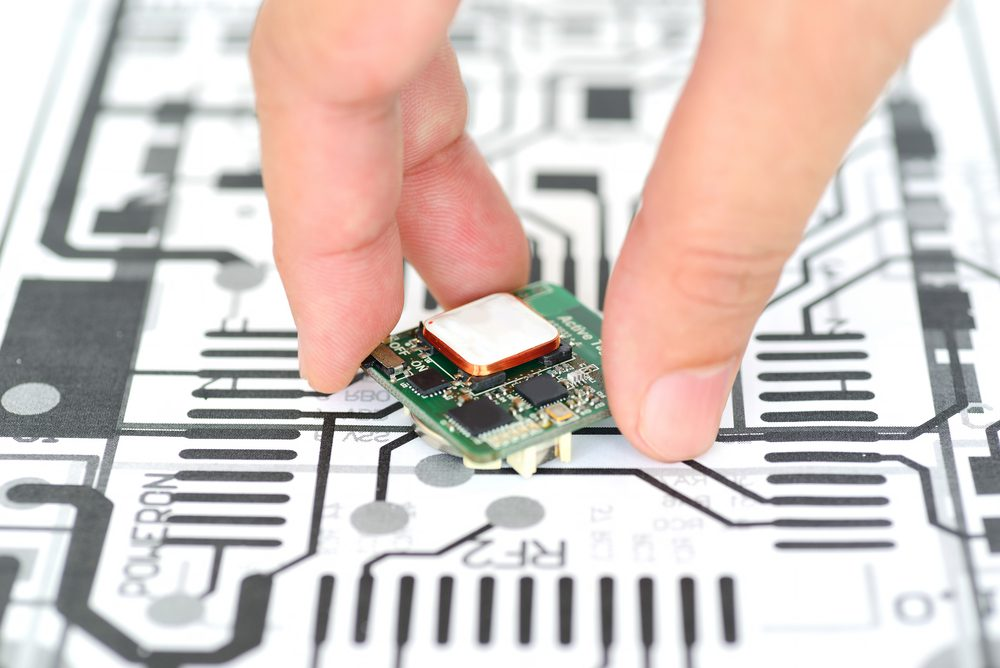 Hand picking up a PCB