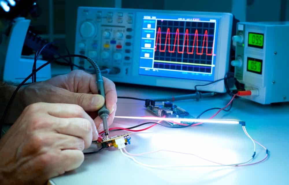 Technician testing electronic equipment