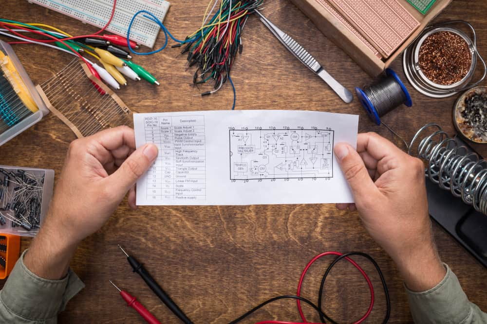 Preparing to build a circuit by reading the schematic